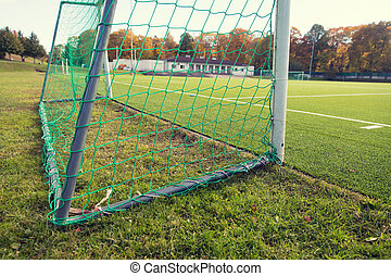 close up of football goal on field - sport and equipment...