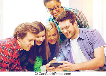 students looking at smartphone at school - education and...