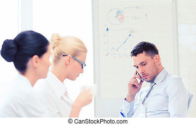stressed male boss on business meeting with team in office