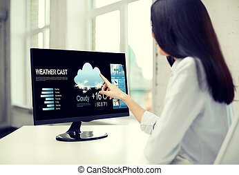 close up of woman with weather cast on computer - business,...
