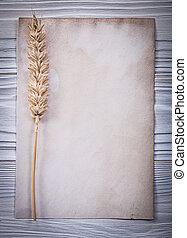 Wheat ear clean vintage paper on wooden board top view