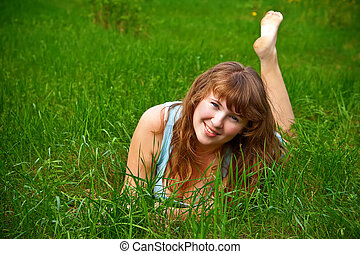 Smiling Woman On A Grass - portrait of a beautiful female...