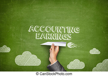 Accounting earnings concept on blackboard with paper plane -...