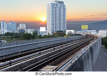Skytrain rails with residence area and sunset light - View...