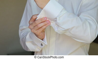 The groom wears a tie and cufflinks boutonniere in full HD