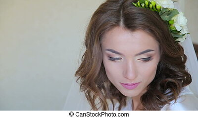 Face of young bride's opening eyes and smiling in fyll HD