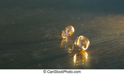 Golden wedding rings circling on the table in full HD