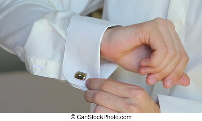 Close up of young man cufflinks boutonniere in full HD