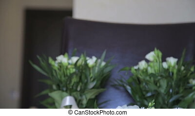 Wedding bouquets on a chair in full HD