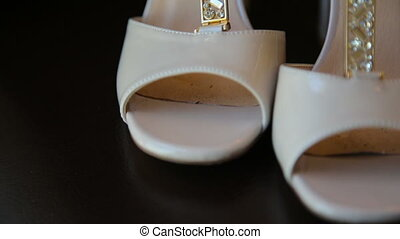 Brides wedding shoes decorated with rhinestones on the black...