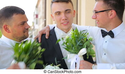 Funny groom with two friends in full HD