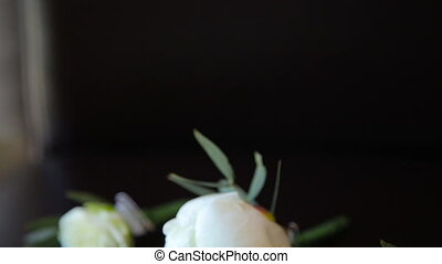 Beige wedding roses on the black background in full HD
