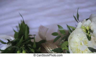 Close up of wedding bouquet on a white tablecloth in full HD