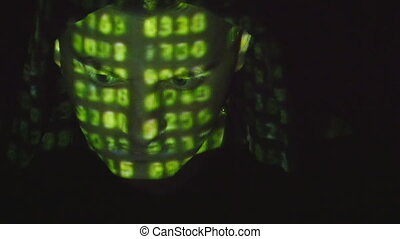Source code projected over an angry hostile mans face, black...