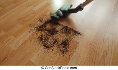 Vacuuming a mess floor. - Close up of the head of a modern...
