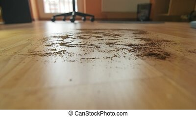 Vacuuming a mess floor - Close up of the head of a modern...