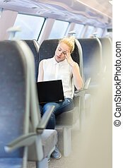 Woman sleeping while travelling by train.