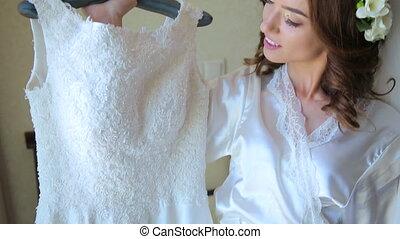 Wonderful bride tries on wedding dress in full HD