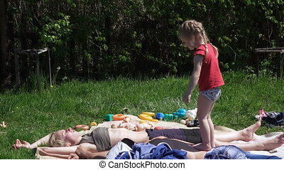 Girl with parents on picnic
