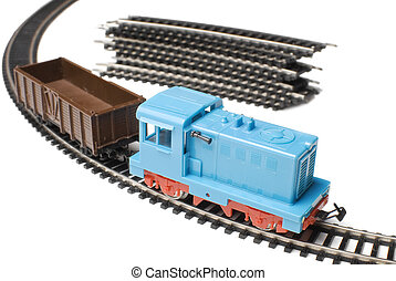 Toy train | Isolated - Blue toy locomotive and brown wagon...