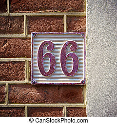 Number 66 - cast metal house number sixty six, painted red...