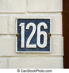 Number 126 - Molded house number one hundred and twenty six