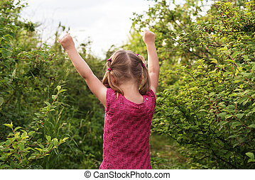 Little girl with her hands up - Little girl standing...