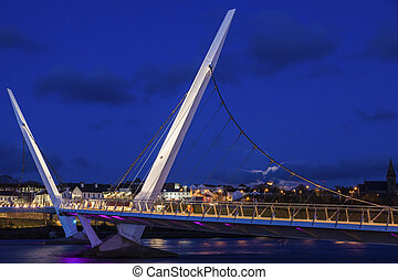 Full moon rising by Peace Bridge in Derry. Derry, Northern...