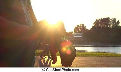 4K steadicam clip of sunset park runner using his smartwatch fitness tracker