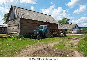 Farm tractor, North Russian village. Kenozerye. Arkhangelsk...