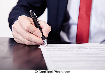 Business man signing a contract. A hand holding a fountain...