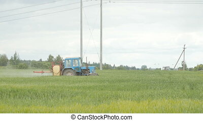 Tractor spray fertilize field with chemicals - Tractor spray...