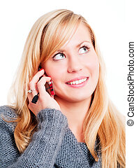 smiling blond woman calling by phone - closeup of smiling...