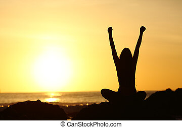 Excited euphoric woman looking sun at sunrise