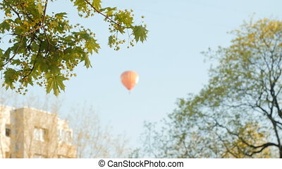 Hot air balloon over blue sky.City - Hot air balloon over...