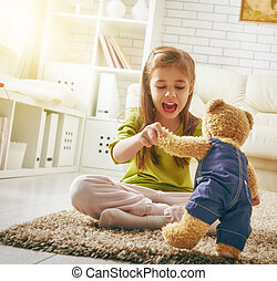girl with teddy bear - funny child girl plays at home. girl...
