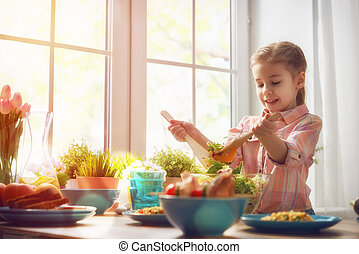 Healthy food at home - Cute little child girl sets the table...