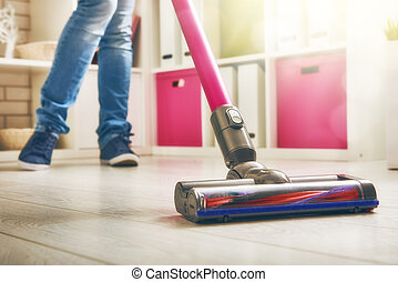 woman makes cleaning the house Woman vacuums the floor