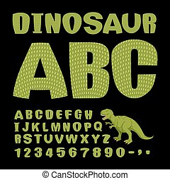 Dinosaur ABC. Font of prehistoric reptile. Green letters. Texture of skin of lizard. Dino Monster alphabet. Set of ancient animals letters