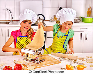 Child making homemade pasta. - Children making homemade...