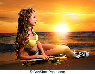 Beautiful and fashion young woman posing at sunset with...