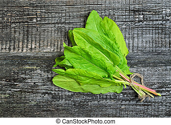 Sorrel on wooden background, top view