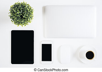 Desktop with technology - Top view of bright desktop with...