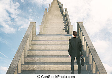 Success concept man on stairs - Success concept with...