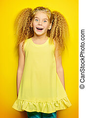 laughing child - Joyful little girl with beautiful blonde...