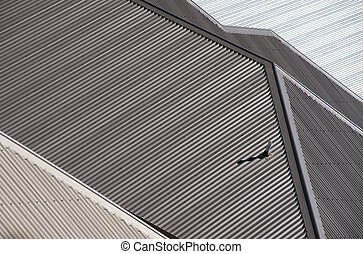Roofs in Suburbia - New metal corrugated roofs in densely...