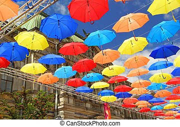 Bright colors and umbrellas flying in the Salt side street...