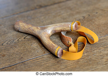Catapult - Traditional hand made wooden catapult on wood