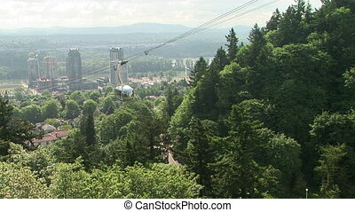 Portland Aerial Tram - Aerial tram going up a hillside in...