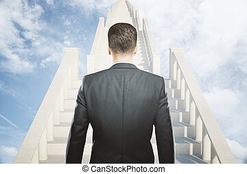 Success concept businessman on stairs - Success concept with...
